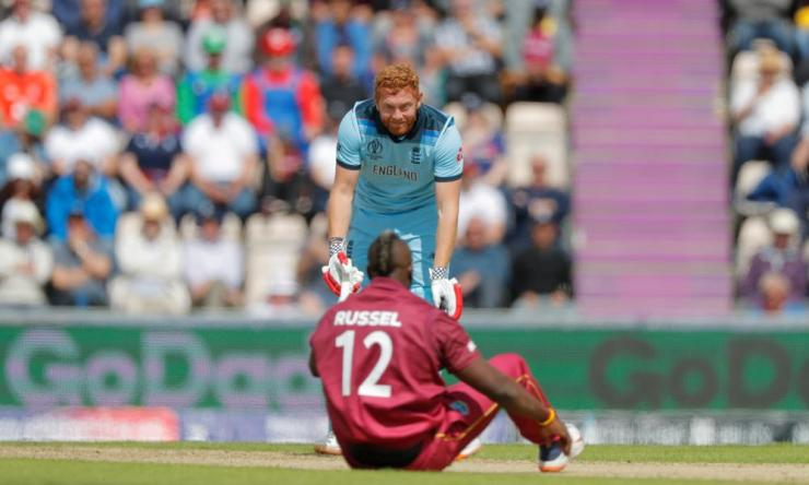 England's Jonny Bairstow looks at West Indies Andre Russell after he took a ball on the helmet.