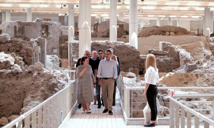Greek prime minister Kyriakos Mitsotakis (R) visiting the archaeological site of Akrotiri on Santorini Island, on Saturday.