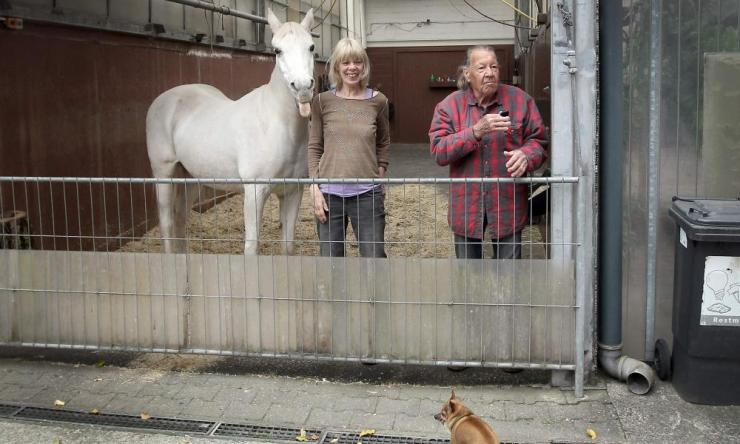 Jenny stands next to her owners Anna (C) and Werner Weischedel as she is getting ready for her daily walk in Fechenheim near Frankfurt am Main, western Germany, on 28 April 2020.