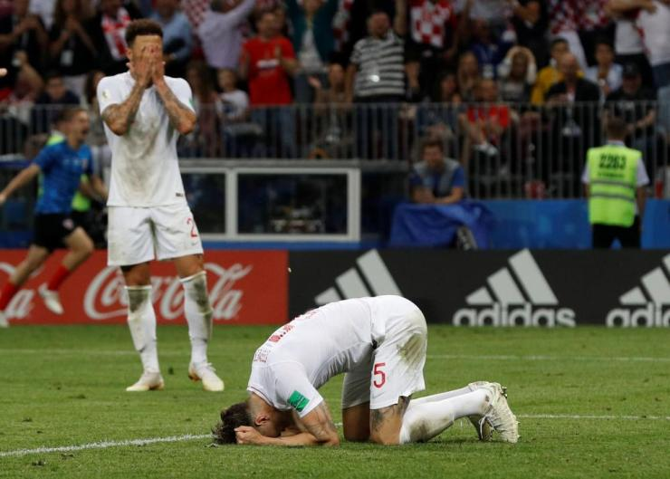England's John Stones and Kyle Walker react after conceding their second goal scored by Croatia's Mario Mandzukic.