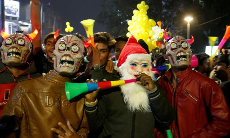 Revellers in Ahmedabad dressed up for the occasion.
