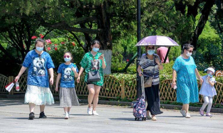 People wearing face masks visit Zhongshan Park on the second day of the 5-day International Workers' Day holiday on 2 May 2020 in Wuhan, Hubei Province of China.