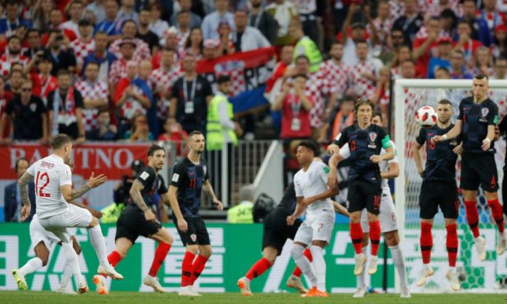 England's Kieran Trippier scores their first goal from a free kick.