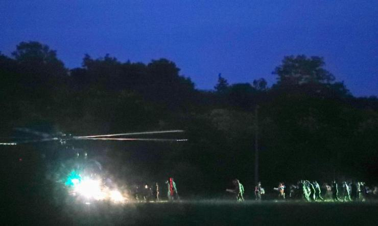 A military helicopter lands to carry some of the rescued boys.
