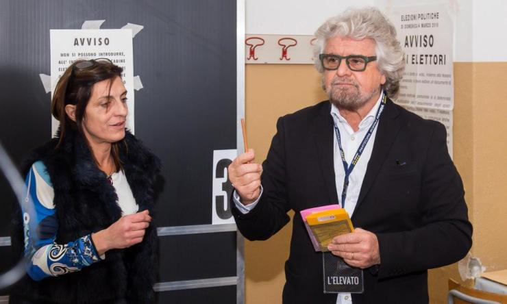Five Star founder Beppe Grillo prepares to cast his vote at a polling station in Sant'Ilario, Genoa.