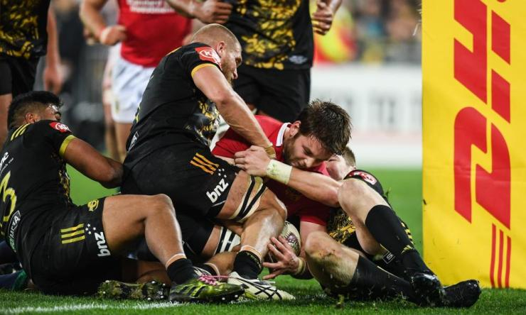 The Lions' Iain Henderson is held up short of the try line.
