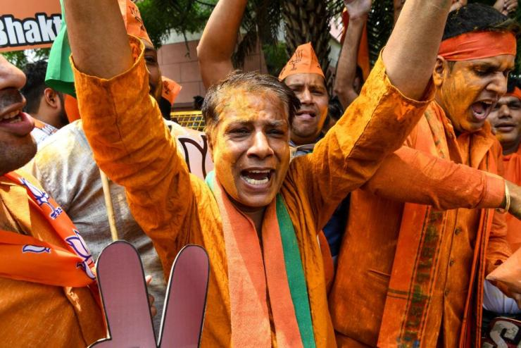 BJP supporters celebrate on vote results day in Delhi.