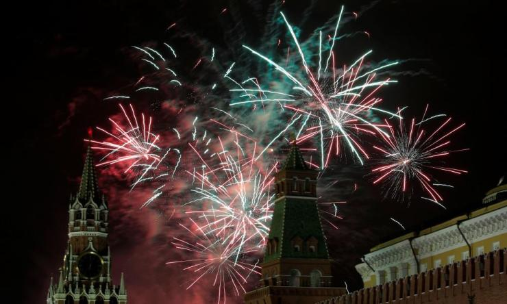 Russians began the world's longest continuous New Year's Eve with fireworks and a message from President Vladimir Putin urging them to work together in the coming year.