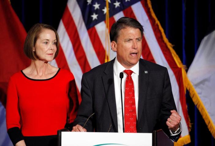 North Carolina Governor Pat McCrory tells supporters that the results of his contest against Democratic challenger Roy Cooper will be contested, while his wife Ann looks on.