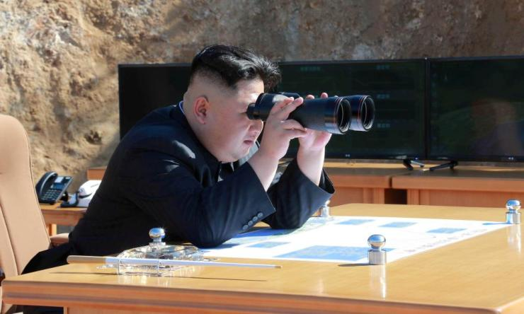 North Korean leader Kim Jong-un looks on during the test-fire of intercontinental ballistic missile Hwasong-14 in this undated photo.