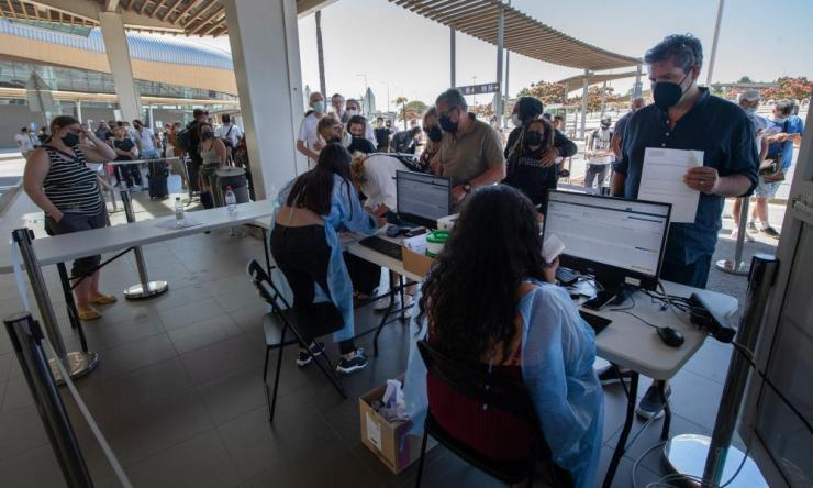 British tourists queue at Faro Airport for Covid-19 tests before flying home.