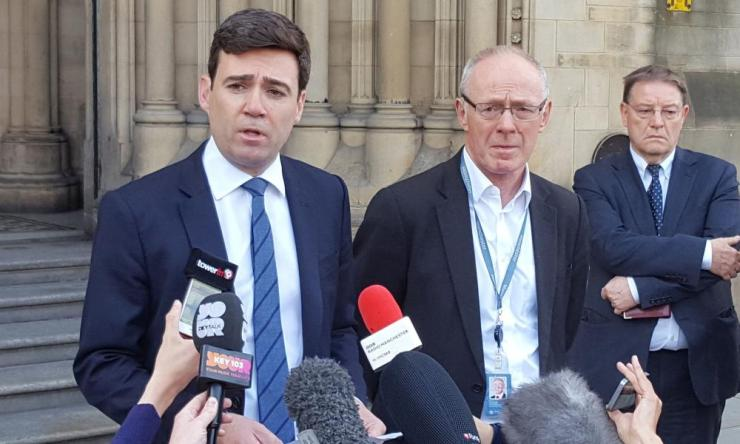 Andy Burnham and Manchester City Council Leader Sir Richard Leese speak to the media outside Manchester Town Hall.