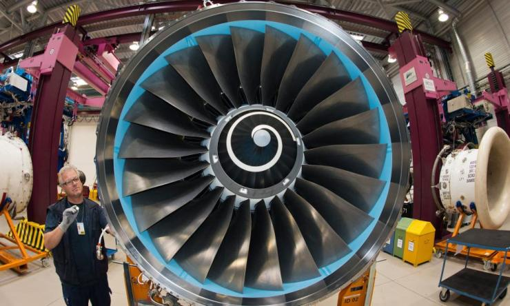 Rolls-Royce working on a plane engine.