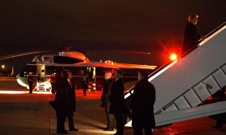 President Donald Trump boarding Air Force One for a trip to the World Economic Forum in Davos, Switzerland.