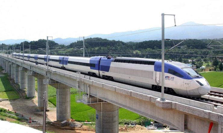 a korail bullet train crossing a valley on a concrete viaduct