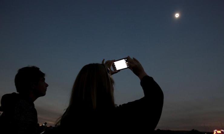 People watch the eclipse in Madras, Oregon.