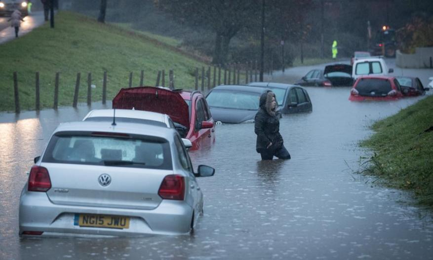 Cars are submerged under several feet of flood water in Hartcliffe, near Bristol, after heavy rain in November 2016.