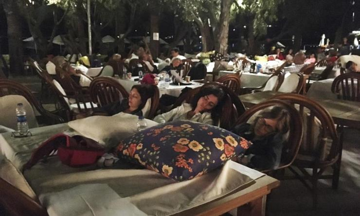 Hotel guests sleep outdoors in Bitez, about 6km from Bodrum, after abandoning their rooms following the earthquake.