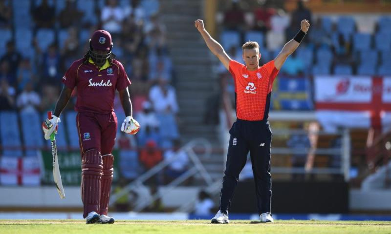 Tom Curran of England celebrates dismissing Shai Hope of the West Indies.