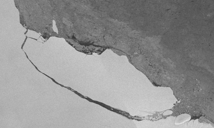A satellite view of the A68 iceberg breaking away from the Larsen C ice shelf.