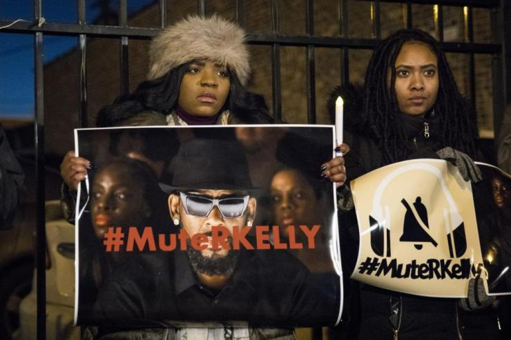#MuteRKelly supporters protesting outside his studio earlier this month.