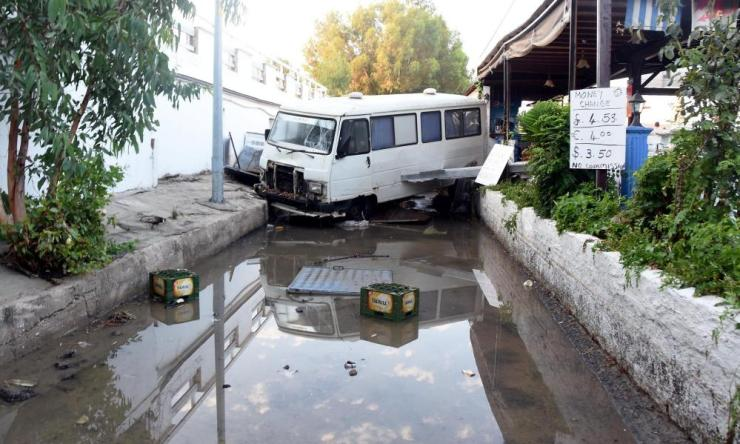 Damaged vehicles and flooding in Bodrum.