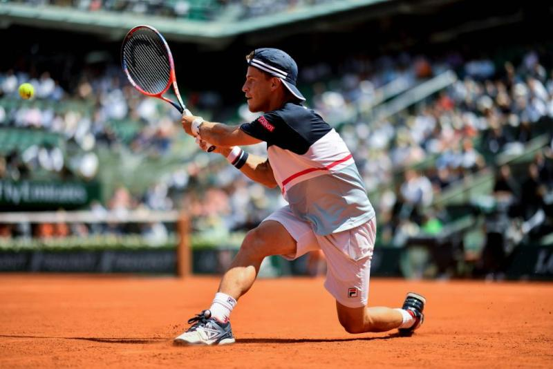 Diego Schwartzman returns the ball to Rafael Nadal.