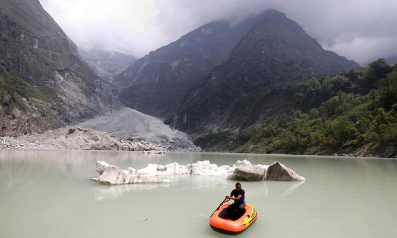 Jagan handles the pack raft on the glacier lake, Nepal