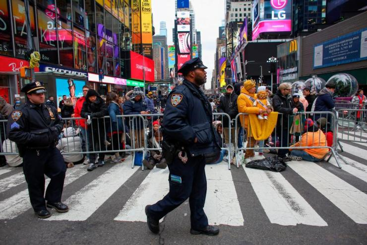 NYPD officers patrol before the New Years eve celebration.