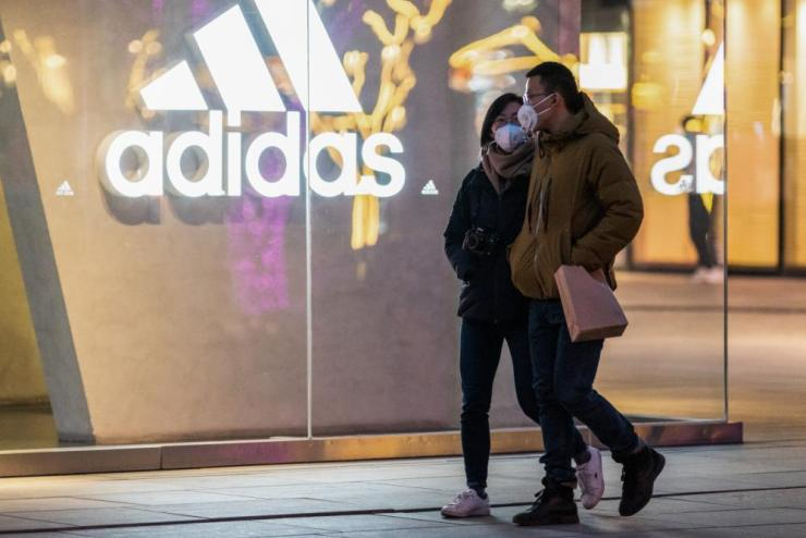 People outside an Adidas outlet in Beijing.