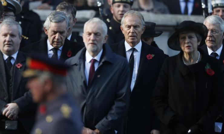 Britain's Prime Minister Theresa May, right, Former Prime Minister Tony Blair, center right, Former Prime Minister Tony Blair, rear right, Labour Party leader Jeremy Corbyn, center, and former prime minister Gordon Brown, rear left, attend the Remembrance Sunday ceremony at the Cenotaph in London.