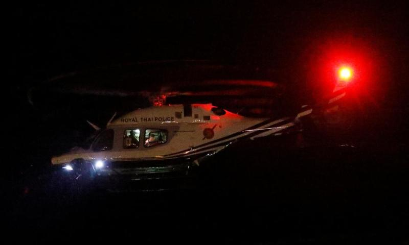 A Royal Thai Police helicopter carrying rescued schoolboys takes off near Tham Luang cave complex.