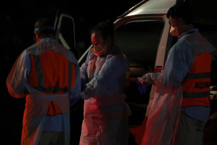 Australian medical assistance (Ausmat) staff prepare to greet the evacuees.