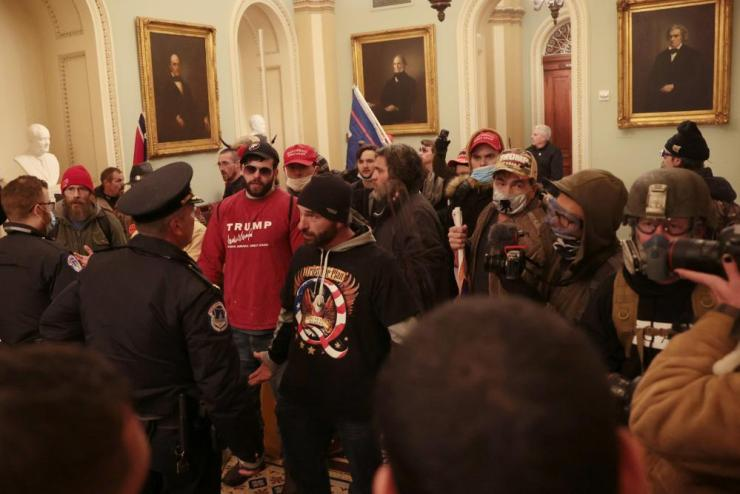 Protesters interact with Capitol Police inside the U.S. Capitol Building.