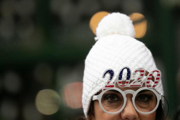 A reveller in New York wears 2020 glasses.