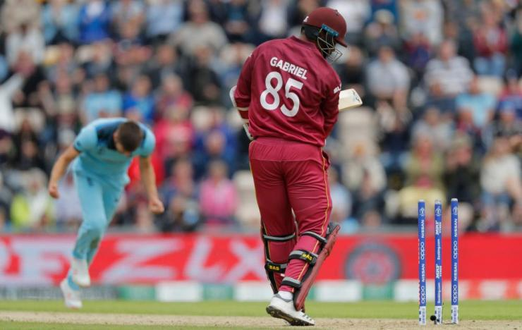 Mark Wood of England celebrates after bowling Shannon Gabriel.