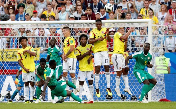 Senegal's Sadio Mane slips as he takes a free kick.