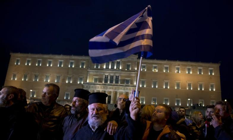 Greek Orthodox priests joined the rally.