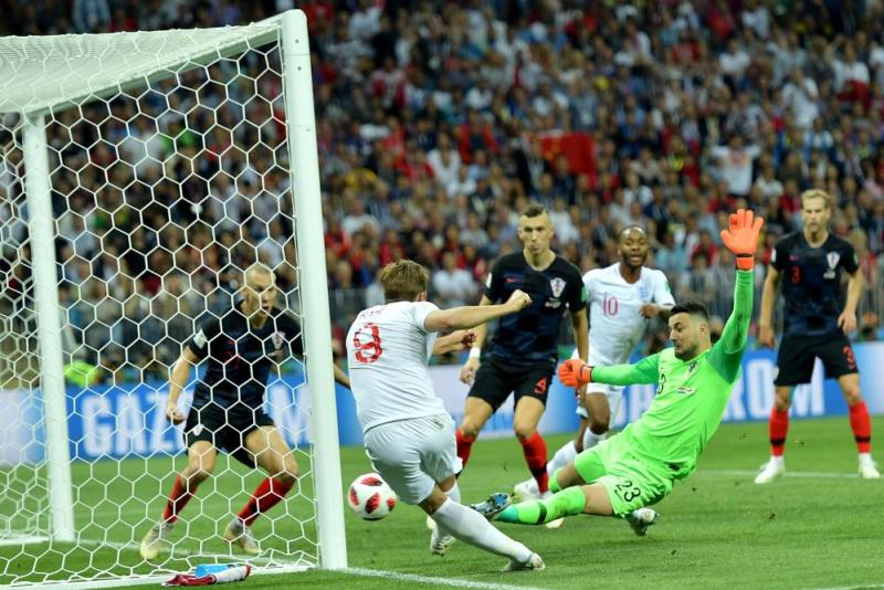 Harry Kane is thwarted again this time by the upright.