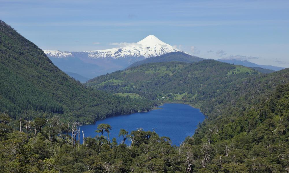 View from Huerquehue national park across Lago Tinquilco and Valdivian forest to the volcano Villarrica.