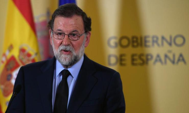 """Spanish Prime Minister Mariano Rajoy speaks during a press conference after a meeting following the attack of Barcelona on August 17, 2017, when a van ploughed into the crowd, killing at least 13 people and injuring around 100 others on the Rambla in Barcelona. A driver deliberately rammed a van into a crowd on Barcelona's most popular street on August 17, 2017 killing at least 13 people before fleeing to a nearby bar, police said. Officers in Spain's second-largest city said the ramming on Las Ramblas was a """"terrorist attack"""". The driver of a van that mowed into a packed street in Barcelona is still on the run, Spanish police said / AFP PHOTO / LLUIS GENELLUIS GENE/AFP/Getty Images"""