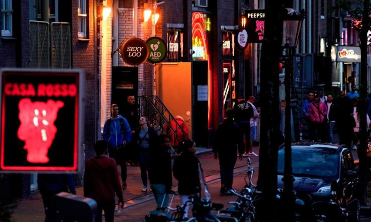 People in Amsterdam's red light district as brothels reopened after a long coronavirus shutdown.