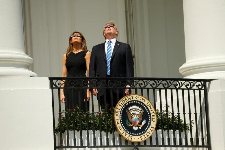 U.S. President Trump watches the solar eclipse with first Lady Melania Trump from the Truman Balcony at the White House in Washington.