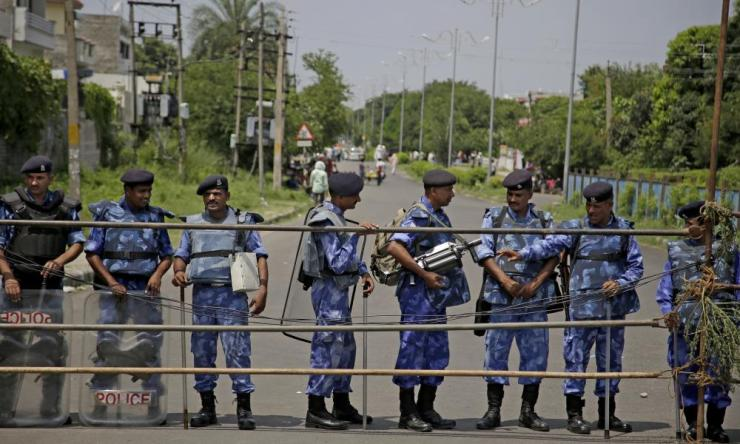 Indian anti-riot police officers stand guard on a barricaded road leading to the court in Panchkula.