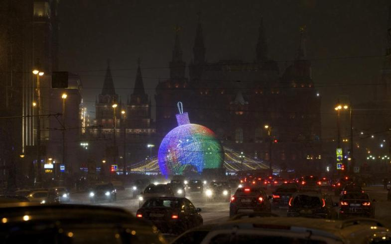 A giant Christmas bauble is installed for New Year and Christmas celebrations at the Manezhnaya square in downtown Moscow, Russia, on Wednesday, Dec. 30, 2015. (AP Photo/Ivan Sekretarev)