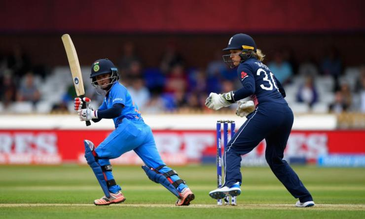 India's Poonam Raut hits out watched by Sarah Taylor