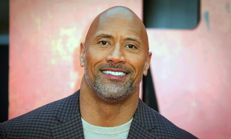 "Dwayne ""the Rock"" Johnson hosted a globally broadcast concert calling on world leaders to make coronavirus tests and treatment available and equitable for all. (Photo by Vianney Le Caer/Invision/AP, File)"