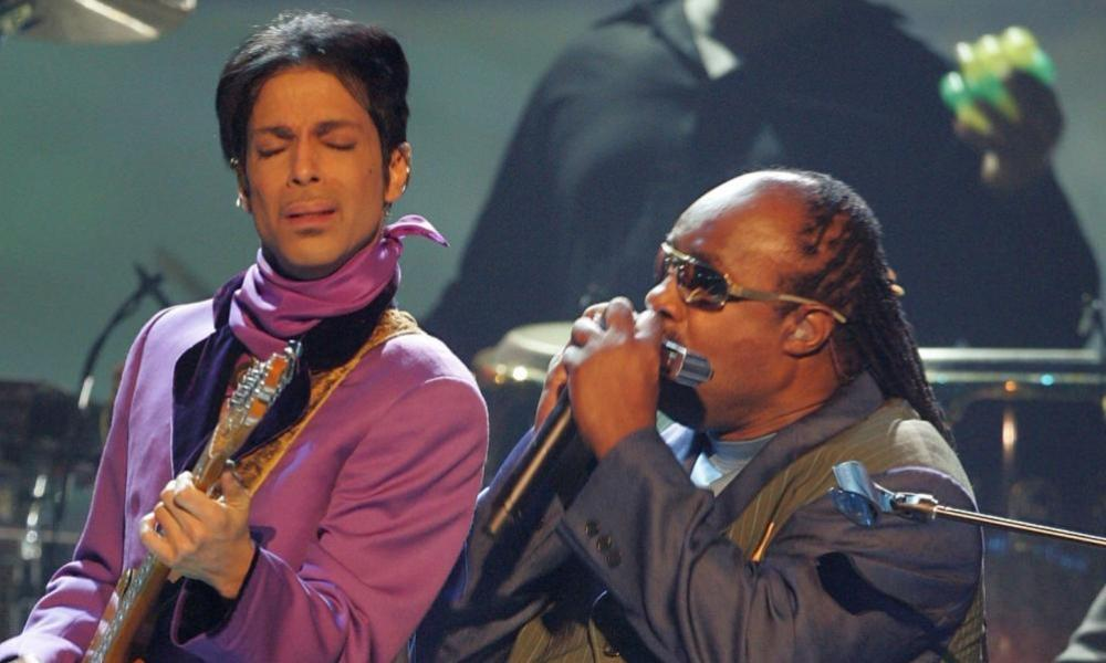 Prince (L) and Stevie Wonder perform onstage at the 2006 BET Awards