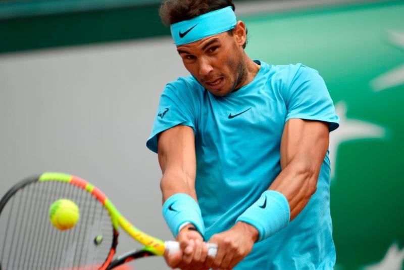Rafael Nadal fires a return to Diego Schwartzman.