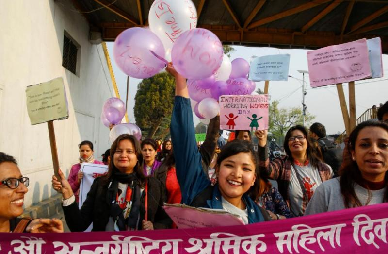 International Women's Day in Kathmanduepa06588111 Nepalese women hold placards and balloons during a rally to mark International Women's Day in Kathmandu, Nepal, 08 March 2018. According to reports, thousands of women affiliated with various political parties and non-government organizations participated in the rally, calling for equal social, economic and politics rights for women. EPA/NARENDRA SHRESTHA